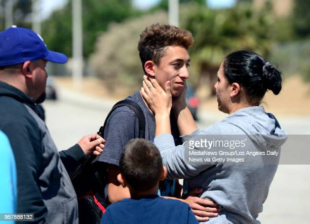 Jennifer Monpano holds her son Ruben MurilloVilla as the family was reunited outside Highland High School in Palmdale after Sheriff took the school...