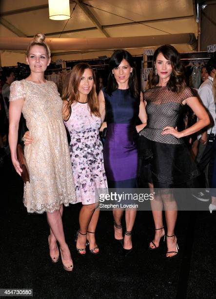 Jennifer Morrison Monique Lhuillier Perrey Reeves and Abigail Spencer pose backstage at the Monique Lhuillier fashion show during MercedesBenz...