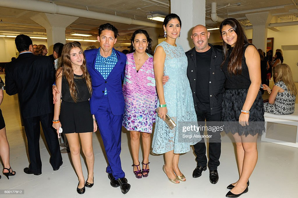 Jennifer Nader (3rd right) and Gary Nader (2nd right )attend SWAY Alfalit Gala at Gary Nader Art centre on December 5, 2015 in Miami, Florida.