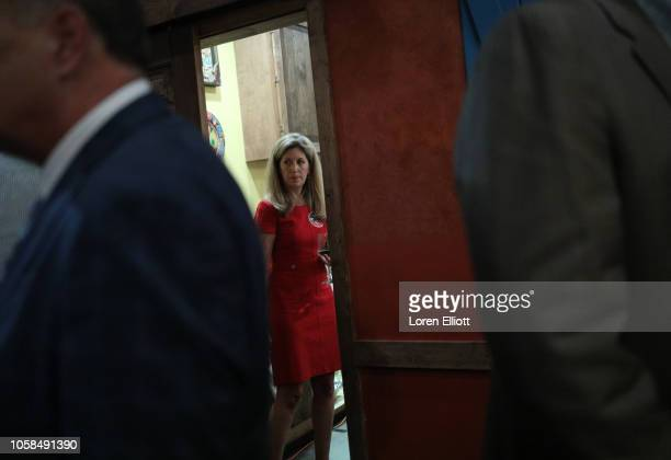 Jennifer Naedler finance director for US Rep John Culberson looks out from a private room at Culberson's election night party on November 6 2018 in...