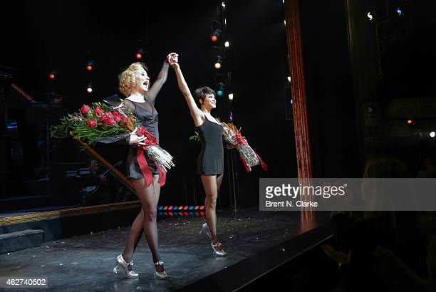 Jennifer Nettles and Carly Hughes participate in the curtain call following their debut as Roxie Hart and Verma Kelly in the Broadway musical...