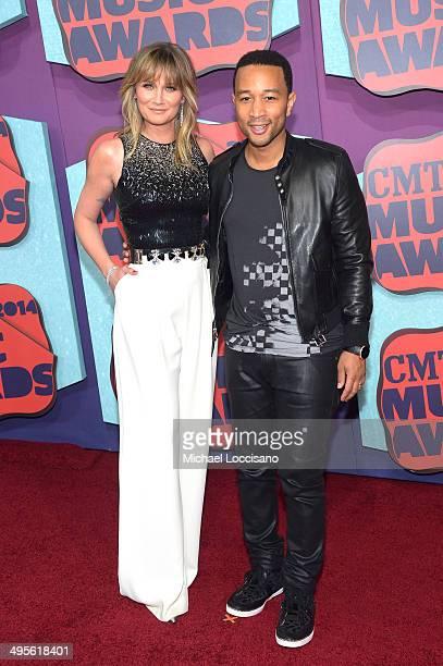 Jennifer Nettles and John Legend attend the 2014 CMT Music awards at the Bridgestone Arena on June 4 2014 in Nashville Tennessee