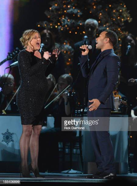 Jennifer Nettles and John Legend perform during the 2012 Country Christmas concert on November 3, 2012 at the Bridgestone Arena in Nashville,...