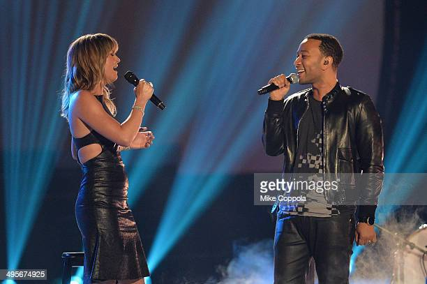 Jennifer Nettles and John Legend perform onstage during the 2014 CMT Music awards at the Bridgestone Arena on June 4, 2014 in Nashville, Tennessee.