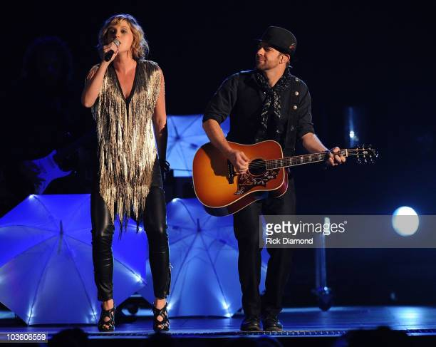 """Jennifer Nettles and Kristian Bush of Sugarland perform """"Love"""" on stage during the 42nd Annual CMA Awards at the Sommet Center on November 12, 2008..."""