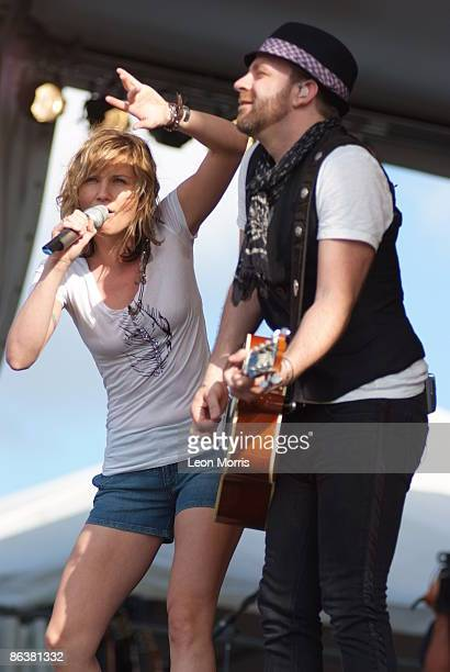 Jennifer Nettles and Kristian Bush of Sugarland performing on stage at the New Orleans Jazz & Heritage Festival on May 1, 2009 in New Orleans.