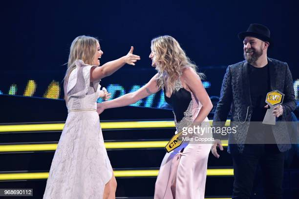 Jennifer Nettles and Kristian Bush of Sugarland present Kane Brown and Lauren Alaina with an award at the 2018 CMT Music Awards at Bridgestone Arena...