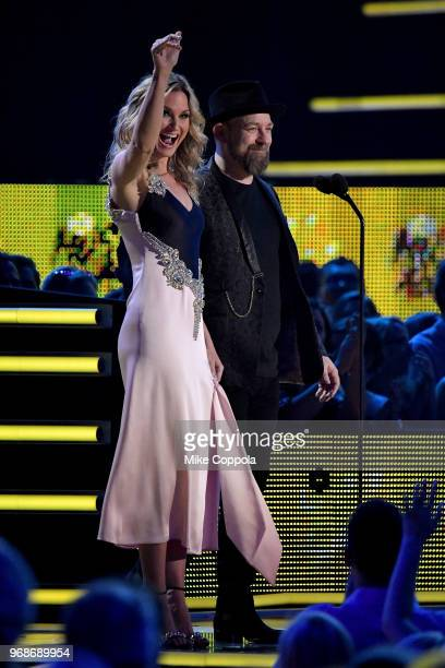 Jennifer Nettles and Kristian Bush of Sugarland speak onstage at the 2018 CMT Music Awards at Bridgestone Arena on June 6 2018 in Nashville Tennessee