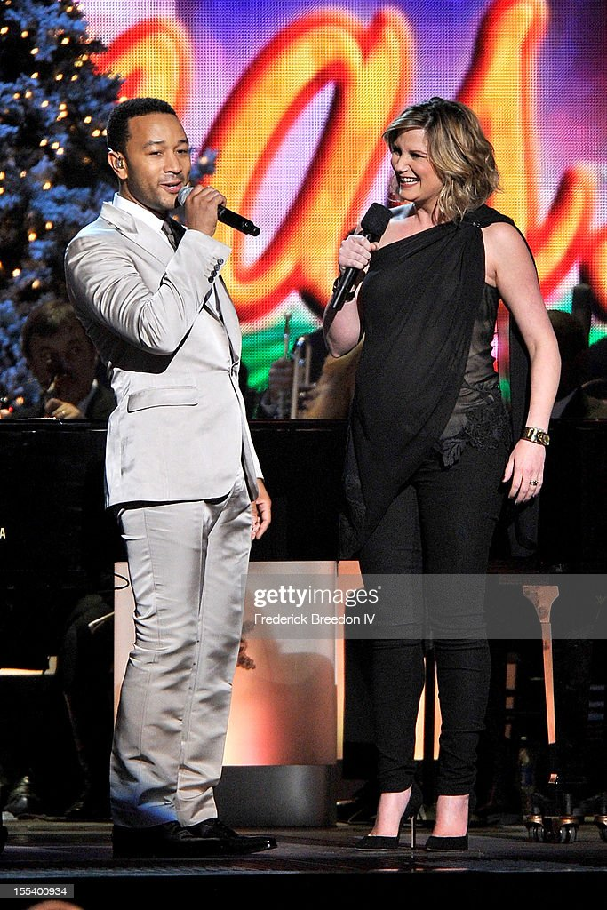 Jennifer Nettles (R) introduces John Legend during the 2012 Country Christmas at the Bridgestone Arena on November 3, 2012 in Nashville, United States.