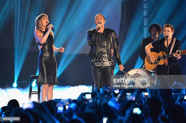 Jennifer Nettles, John Legend and Hunter Hayes perform onstage during the 2014 CMT Music awards at the Bridgestone Arena on June 4, 2014 in...