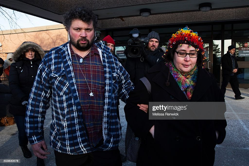 Jennifer Neville-Lake and her husband, Edward, walk to their car after speaking to the media after Marco Muzzo to pleads guilty in deadly Vaughan crash. : ニュース写真