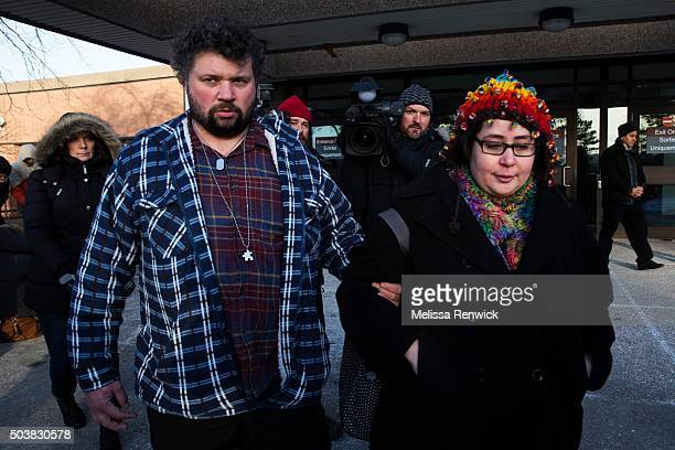 Jennifer Neville-Lake and her husband, Edward, walk to their car after speaking to the media after Marco Muzzo to pleads guilty in deadly Vaughan...
