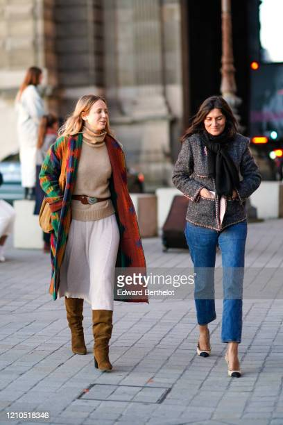 Jennifer Neyt wears a turtleneck pullover, a belt, a colored coat, a white skirt, brown pointy suede boots ; Emmanuelle Alt wears a jacket, blue...