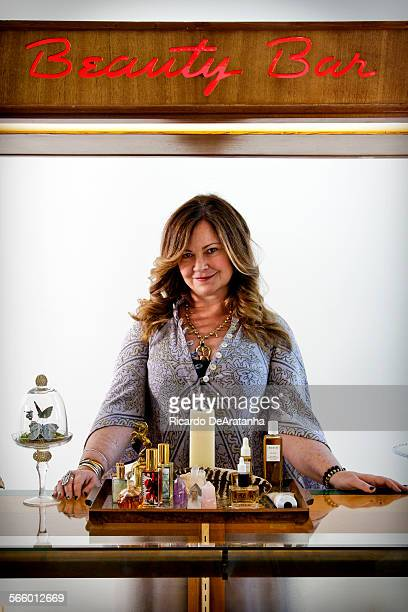 Jennifer Nicholson wearing a GoldDust dress and a necklace by LAbased jeweler Jessica Seaton is behind the Beauty Bar at Pearl Drop on Lincoln...