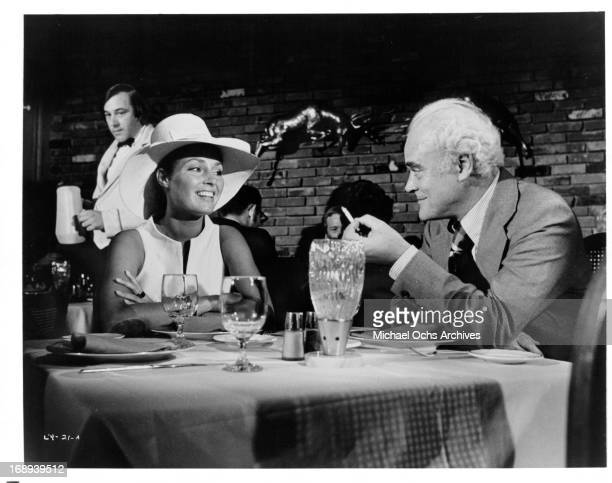 Jennifer O'Neill and Patrick Magee at dinner in a scene from the film 'Lady Ice' 1973