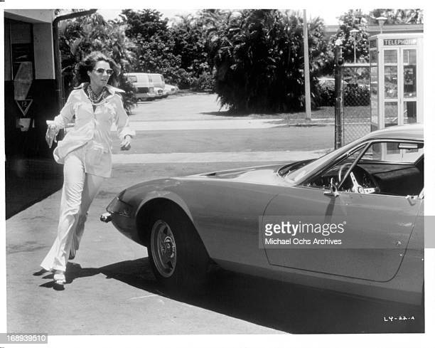 Jennifer O'Neill runs to her car in a scene from the film 'Lady Ice' 1973