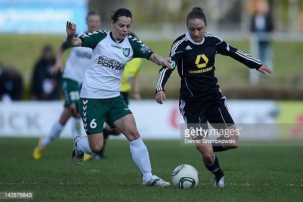 Jennifer Oster of Duisburg and Gina Lewandowski of Frankfurt battle for the ball during the Women's DFB Cup semi final match between 1. FFC Frankfurt...