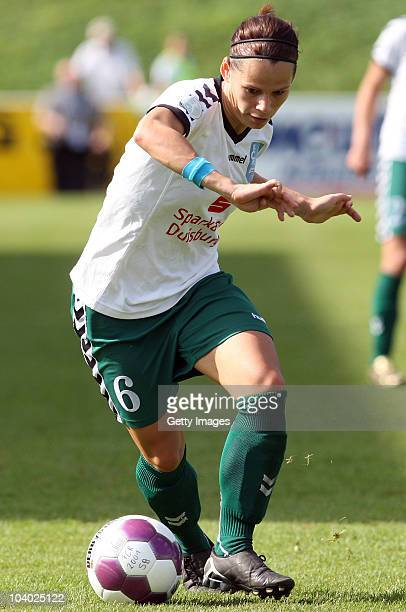 Jennifer Oster of Duisburg runs with the ball during the Women's bundesliga match between FCR Duisburg and FFC Frankfurt at the PCCStadium on...