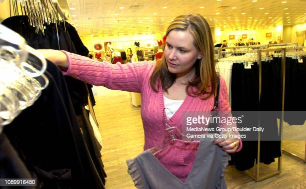 Jennifer Otten of Longmont shops for an outfit to wear to her company's holiday party at Ann Taylor Loft December 11 2006 at the 29th Street Mall