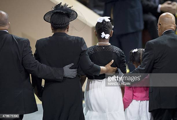 Jennifer Pinckney the wife of Rev and South Carolina State Sen Clementa Pickney with daughters Eliana and Malana stand at a funeral before US...