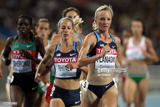 Jennifer Rhines and Shalane Flanagan of United States compete in the women's 10,000 metres final during day one of the 13th IAAF World Athletics...
