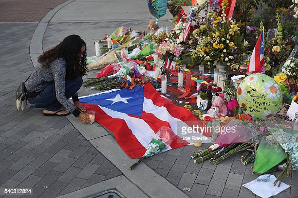 Jennifer Rivera pays her respects as she stops by a memorial setup near the Pulse gay nightclub where Omar Mateen killed 49 people on June 15 2016 in...