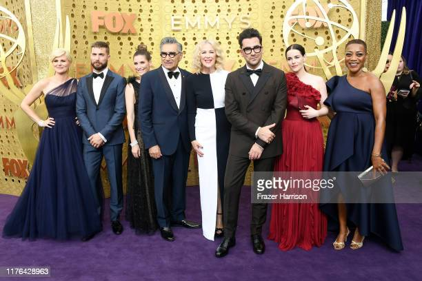 Jennifer Robertson, Dustin Milligan, Sarah Levy, Eugene Levy, Catherine O'Hara, Daniel Levy, and Karen Robinson attend the 71st Emmy Awards at...