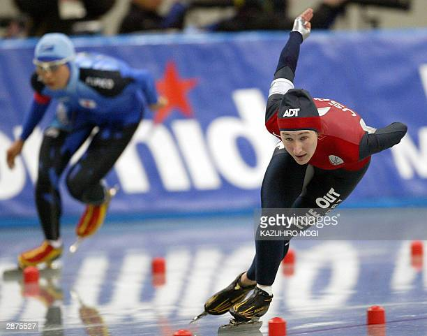 Jennifer Rodrigues of the United States leads against Japanese Aki Tonoike in the women's 1000m at the world sprint championships at the Nagano...