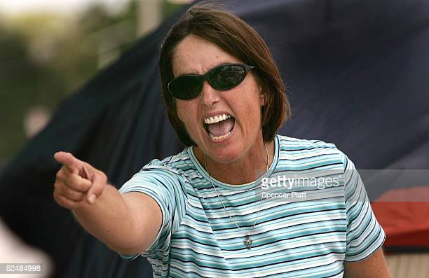 Jennifer Rogers a supporters of Terri Schiavo screams at the police guarding the outside of the Woodside Hospice where Schiavo is being cared for...