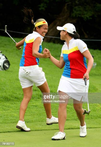 Jennifer Rosales and Dorothy Delasin of The Philippines celebrate holing a birdie putt on the 17th green during the final round of the Women's World...