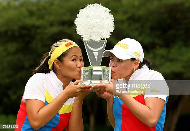 Jennifer Rosales and Dorothy Delasin of The Philippines celebrate victory with the trophy after the final round of the Women's World Cup of Golf at...
