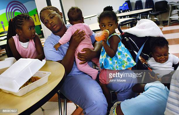 Jennifer Ross, living in a homeless shelter with her five children, sits in the shelter dining hall after dinner on June 18, 2009 in Dallas, Texas....