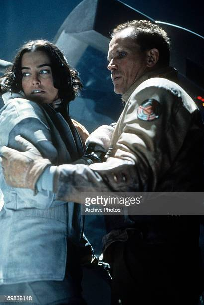 Jennifer Rubin and Peter Weller have a look of concern on their face in a scene from the film 'Screamers' 1995