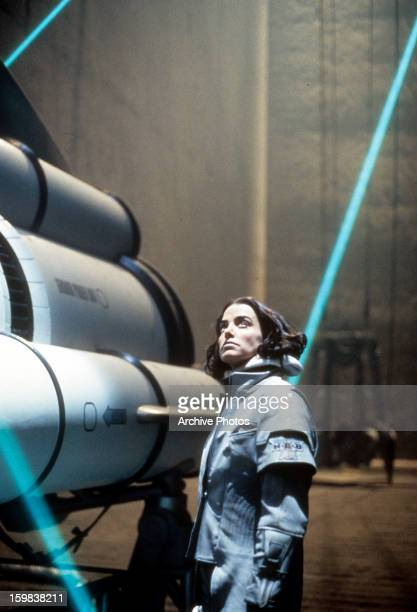 Jennifer Rubin standing next to a airship in a scene from the film 'Screamers' 1995