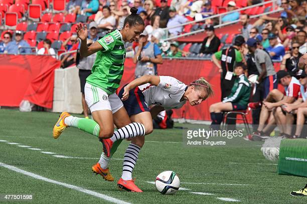 Jennifer Ruiz of Mexico and Eugenie Le Sommer of France get pushed out of bounds chasing down the ball during the FIFA Women's World Cup Canada 2015...