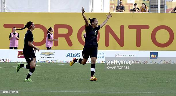 Jennifer Ruiz of Mexico celebrates the third goal against Argentina during their women's group A first round football match for the Pan American...