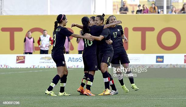 Jennifer Ruiz of Mexico celebrates with teammates the third goal against Argentina during their women's group A first round football match for the...