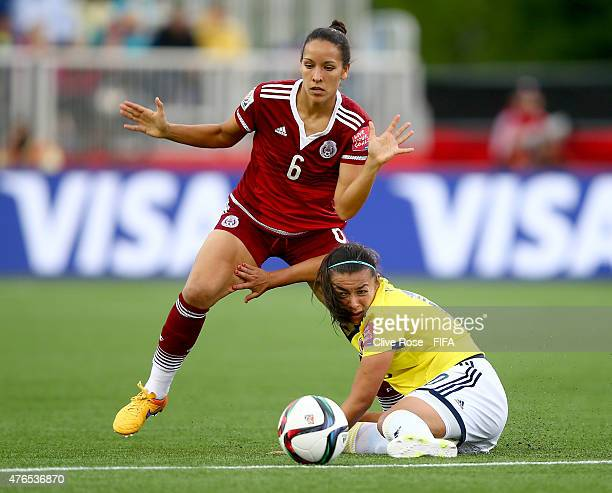 Jennifer Ruiz of Mexico is challenged by Yoreli Rincon of Colombia during the FIFA Women's World Cup 2015 Group F match between Colombia and Mexico...