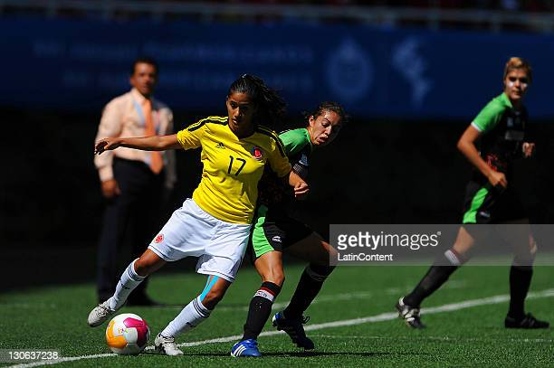 Jennifer Ruiz of Mexico struggles for the ball with Carolina Arias of Colombia during the match for the bronze medal as part of the XVI Pan American...
