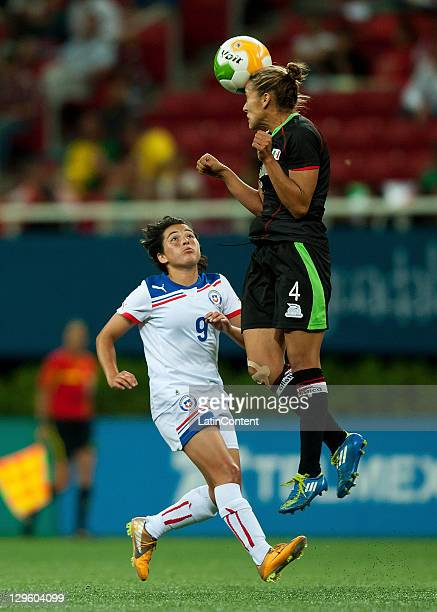 Jennifer Ruiz of Mexico struggles for the ball with Maria Jose Rojas of Chile during the match between Mexico and Chile in the 2011 XVI Pan American...