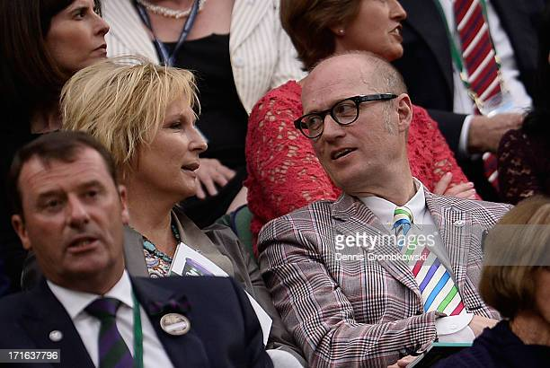 Jennifer Saunders and Ade Edmondson attend Centre Court during day four of the Wimbledon Lawn Tennis Championships at the All England Lawn Tennis and...