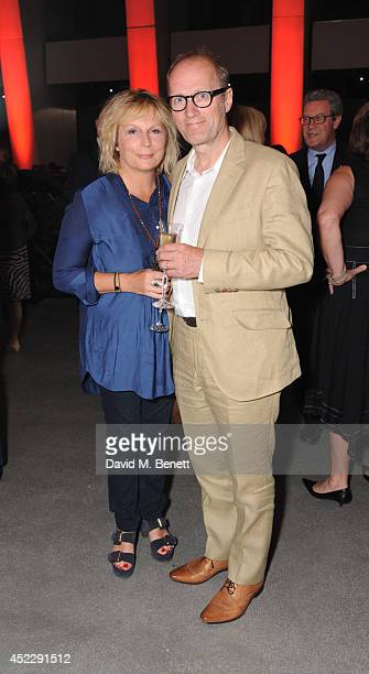 Jennifer Saunders and Adrian Edmondson attend a party to mark the reopening of the Imperial War Museum on July 17 2014 in London England