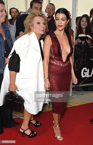 Jennifer Saunders and Kourtney Kardashian arrive for the Glamour Women Of The Year Awards in Berkeley Square Gardens on June 7 2016 in London United...