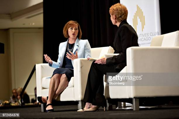 Jennifer Scanlon president and chief executive officer of USG Corp left speaks with Diane Swonk chief economist of Grant Thornton LLP during a...