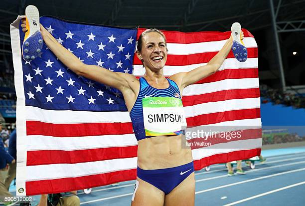 Jennifer Simpson of the United States celebrates with the American flag after winning the bronze medal in the Women's 1500m Final on Day 11 of the...