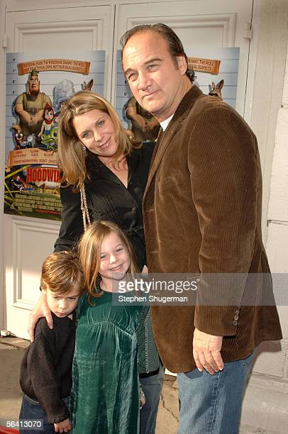 Jennifer Sloan actor Jim Belushi pose with Jared Belushi and Jamison Belushi at the Los Angeles premiere of Hoodwinked at the Mann Festival Theater...