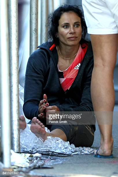 Jennifer Suhr of the United States rests her legs in ice after not entering the women's pole vault during day two of the Adidas Boost Boston Games on...