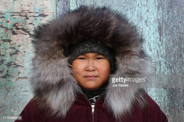Jennifer Swan wears a parky on a cool day on September 13 2019 in Kivalina Alaska Kivalina is situated at the very end of an eightmile barrier reef...