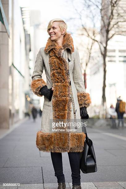 Jennifer Sweas is seen on Michigan Avenue wearing a cotton tapestry and faux fox fur Elevenses coat black Laurie's shear rabbit gloves black G Star...