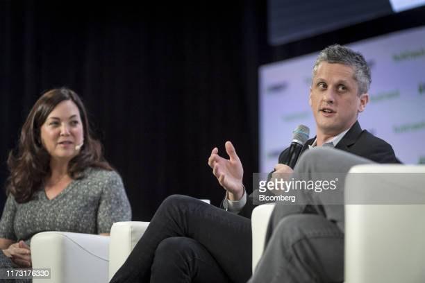 Jennifer Tejada, chief executive officer and chairperson of PagerDuty Inc., left, listens as Aaron Levie, chief executive officer of Box Inc., speaks...
